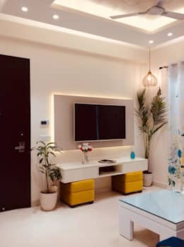 Residence at Astaire Gardens, Gurgaon: modern Living room by INTROSPECS