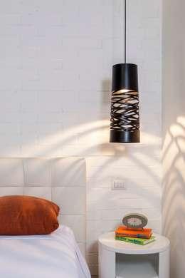 nuove lofts: Recámaras de estilo moderno por studio arquitectura