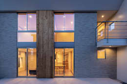 松岡淳建築設計事務所의  주택