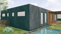Alçado tardoz e piscina: Habitações  por Estúdio AMATAM