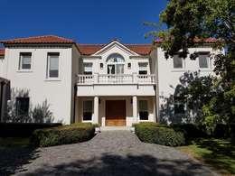 Casa clásica en Highland Club de Campo: Casas unifamiliares de estilo  por Estudio Dillon Terzaghi Arquitectura