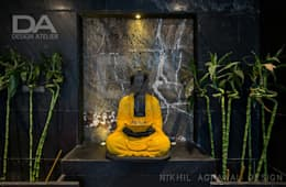 Buddha statue welcoming the guests in party lounge : modern Bathroom by Design Atelier