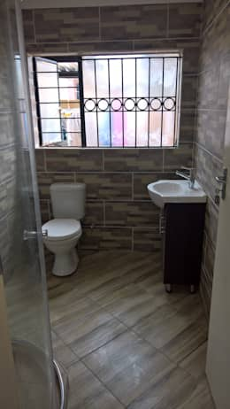Bathroom Renovation: classic Bathroom by Kgodisho Solutions and Projects