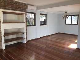 Remodelación y Ampliación Casa La Oración 162: Livings de estilo moderno por Arqsol