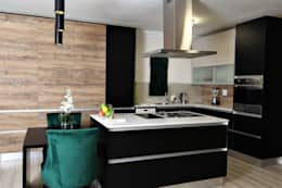 Kitchen:   by Motama Interiors and Exteriors