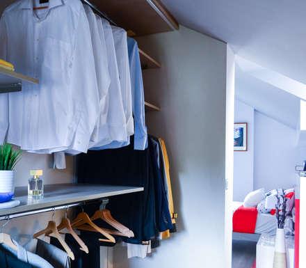 Organiza tu ropa con un vestidor: Vestidores de estilo escandinavo de TEKNIA ESTUDIO