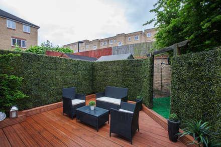 Garden - Canary Wharf: modern Garden by Millennium Interior Designers