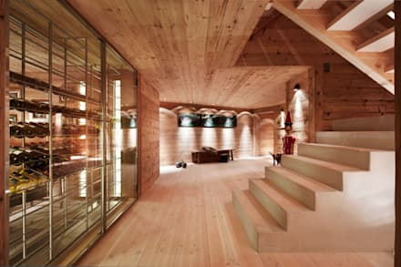 Chalet Gstaad: rustic Wine cellar by Ardesia Design