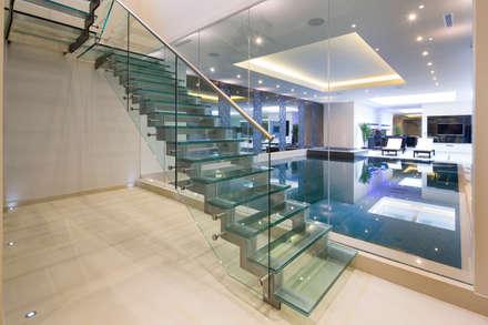Fairways at the Bishops Avenue:  Corridor & hallway by Celia Sawyer Luxury Interiors