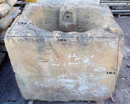 Antigua pila de piedra: Piscinas de estilo industrial de Anticuable.com