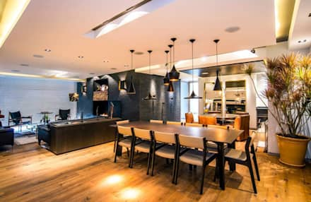 Veramonte I: Comedores de estilo ecléctico por Sobrado + Ugalde Arquitectos