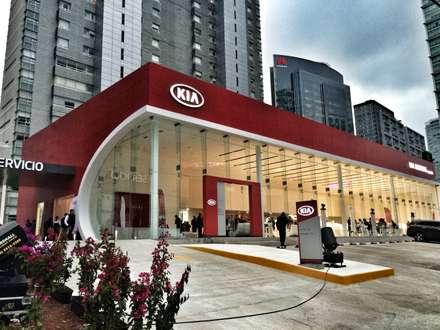 Concesionarias de automóviles de estilo  por REM Arquitectos