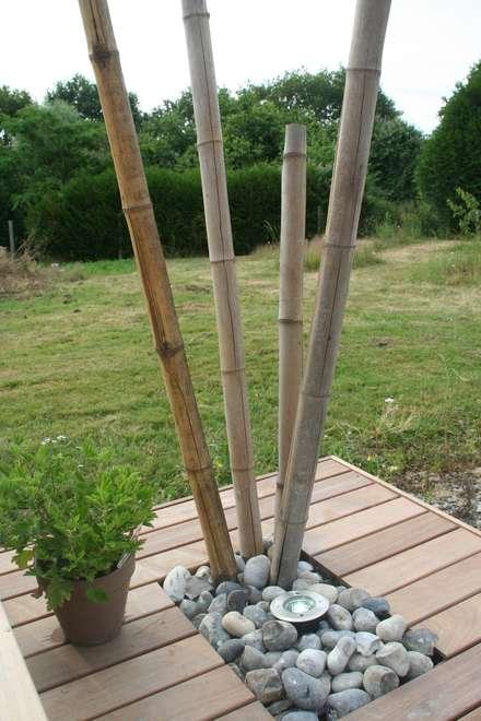 Tubes bambou: Jardin de style de style Asiatique par EURL OLIVIER DUBOIS