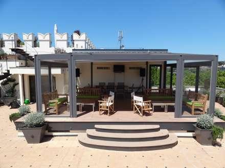 veranda: Giardino d'inverno in stile in stile Moderno di sabigarden