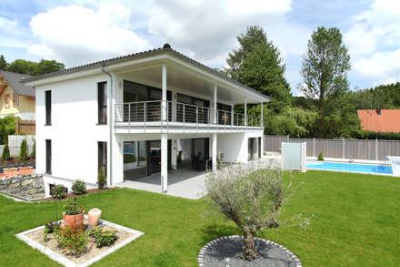 Außenaufnahme: moderner Garten von Bau-Fritz GmbH & Co. KG