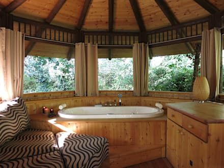 tropical Bathroom by Tree Top Builder