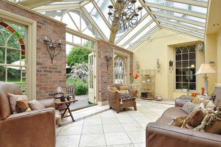 A Garden Room Project: eclectic Conservatory by Deborah Warne Interiors Ltd