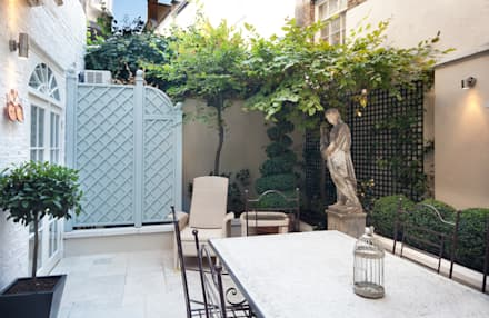 Outside walled garden:  Terrace by David Hales Interior Design