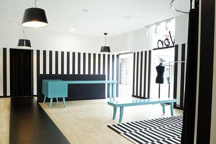 Luci Von. Local comercial para tienda de ropa : Estudios y despachos de estilo ecléctico de Estudio de Arquitectura Sra.Farnsworth