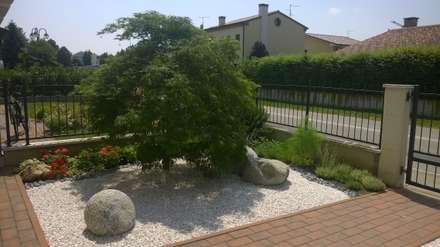 giardino privato: Giardino in stile in stile Asiatico di giardini di lucrezia