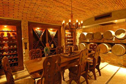 tropical Wine cellar by BR  ARQUITECTOS