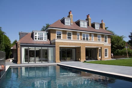 The rear elevation and swimming pool: country Pool by Hale Brown Architects Ltd