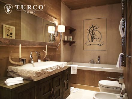 baita di montagna bagno in stile in stile rustico di turco home srl