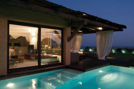 Casa Binisafúller Menorca: Piscinas de estilo mediterráneo de adela cabré
