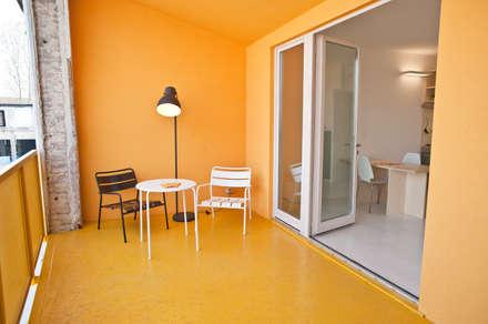 CasaZera: prototipo abitativo sostenibile in aree industriali dismesse, Torino: Terrazza in stile  di TRA - architettura condivisa