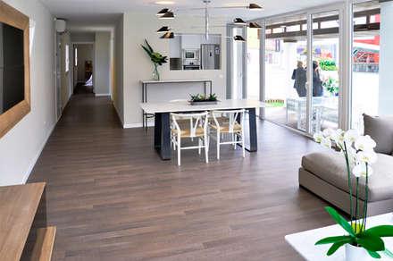 Casa piloto Cube. Salón Comedor.: Casas de estilo moderno de Casas Cube