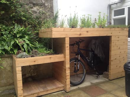 Bike and log store with green roof: modern Garden by Organic Roofs
