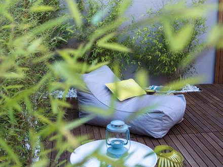 rustic Garden by MUDA Home Design