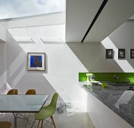 Skylight above dining space: modern Dining room by Neil Dusheiko Architects