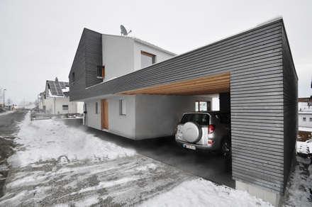 Garajes de estilo ecléctico por Pakula & Fischer Architekten