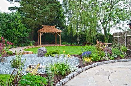 """A view across the garden to the """"tea house"""" inspired seating area: asian Garden by Lush Garden Design"""