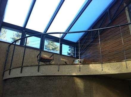 Maison bois sous verre...: Jardin d'hiver de style  par eco-designer
