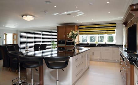 Walnut and hand painted kitchen: modern Kitchen by John Ladbury and Company