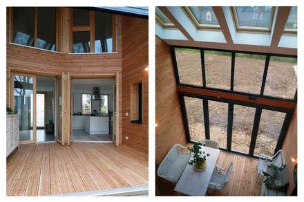 projet maison ossature bois: Jardin d'hiver de style  par yg-architecte