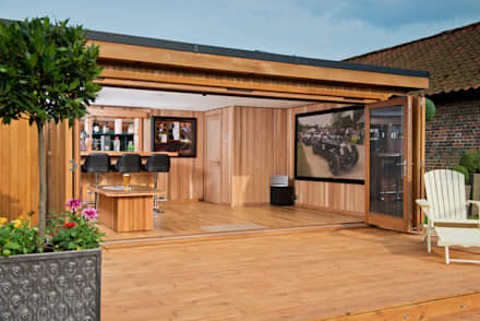 Bespoke garden cinema room with a bar: modern Garage/shed by Crown Pavilions