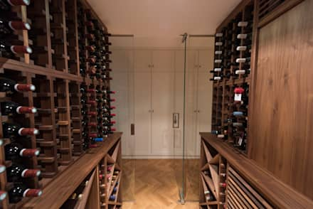 Wine Cellar in American black walnut designed and made by Tim Wood: eclectic Wine cellar by Tim Wood Limited