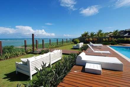 il giardino: Giardino in stile in stile Tropicale di Sintony SRL