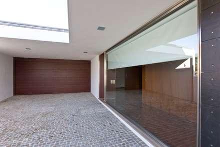 Casa SG: Habitações  por Atelier Lopes da Costa