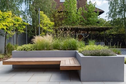 Raised Borders and Seating: modern Garden by Borrowed Space