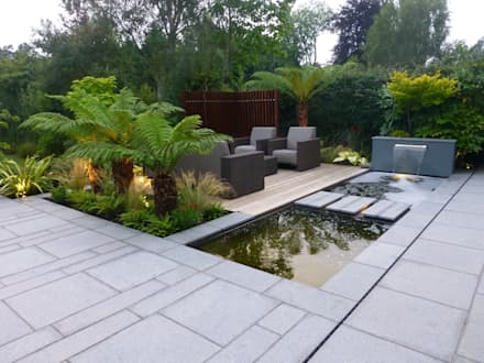 New Granite Terrace with Pool: modern Garden by Garden Arts