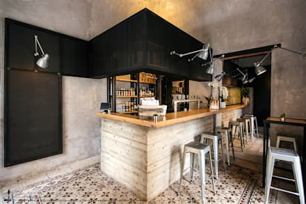 Unto: Bar & Club in stile  di Studio DiDeA architetti associati