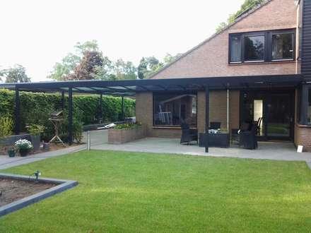 Garages de estilo moderno por Carport Harderwijk