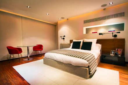 Départamento Vidalta: Recámaras de estilo moderno por Concepto Taller de Arquitectura