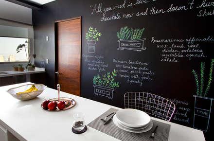 Departamento DG: Cocinas de estilo moderno por Concepto Taller de Arquitectura