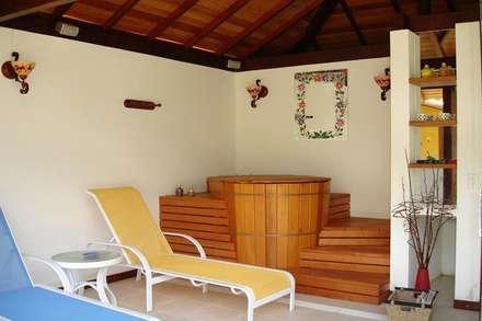 Spa de estilo rústico por Cadore Arquitetura