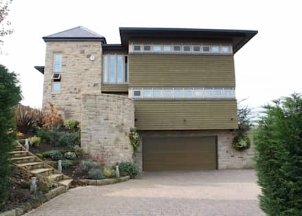 Front Elevation showing Garage: eclectic Houses by Wildblood Macdonald